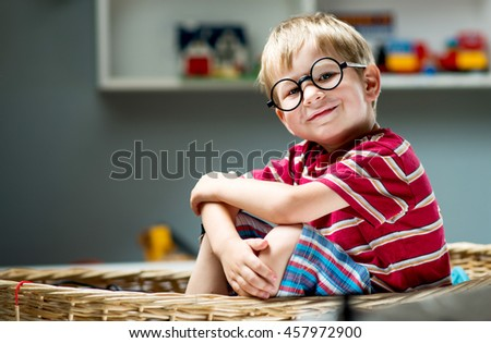 Funny kid boy wearing glasses