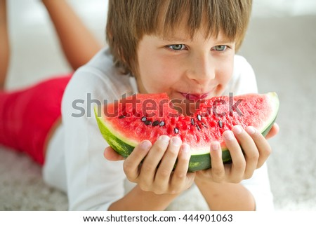 Funny kid eating watermelon. Baby, baby, healthy food