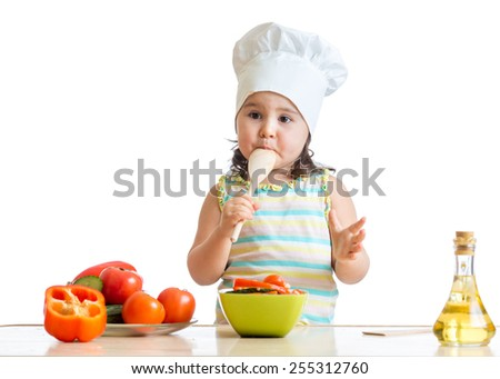 funny kid girl preparing healthy food isolated - stock photo