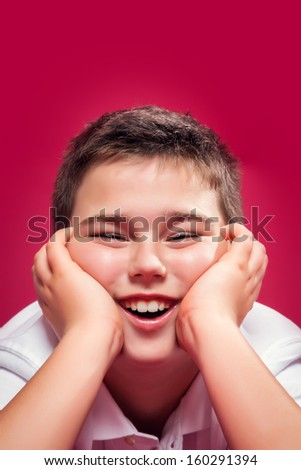 Funny Kid Smiling Over a Red Background