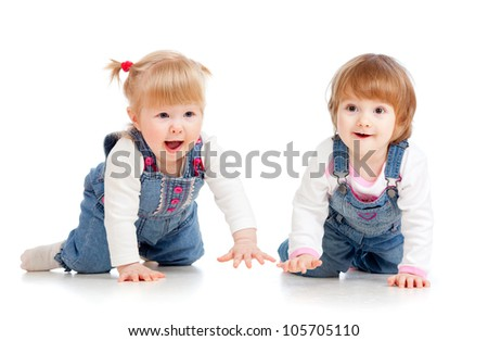 Funny kids girls crawling on floor - stock photo