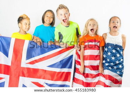 Funny kids holding flag of Great Britain and american national flag. Group of school children. Multiethnic students. Back to school. Friends. Fans, Rio. White background - stock photo