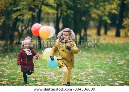 funny kids running around in the park - stock photo