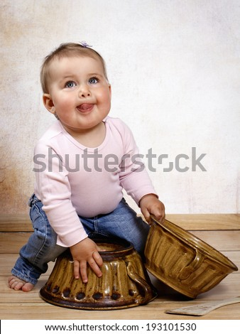 Funny little baby cooking - stock photo