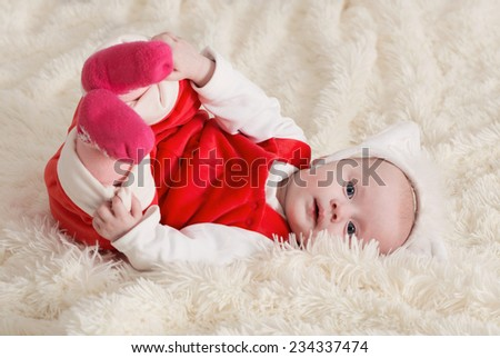 funny little baby  on sofa - stock photo