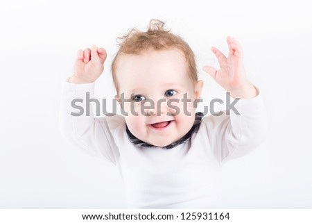 Funny little baby with her hands in the air