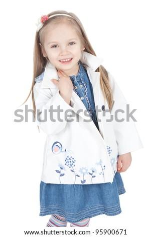 Funny little blonde girl in white raincoat over white - stock photo