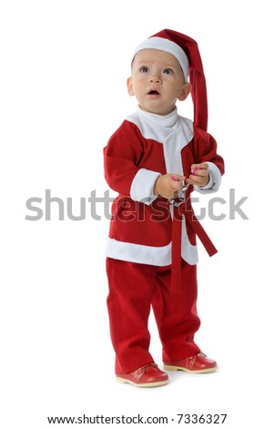 funny little boy in red Santa Claus clothes, isolated on white