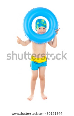 Funny little boy playing with blue life ring in swim caps, isolated in white - stock photo