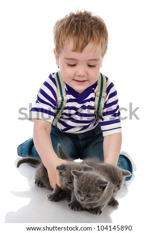 funny little boy playing with british kitten cat. isolated on white background - stock photo