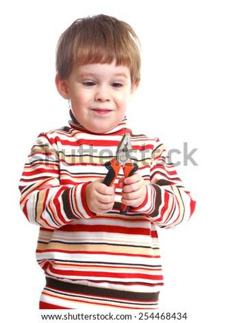 Funny little boy sees pliers. Isolated on white. - stock photo