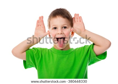 Funny little boy teasing with hands and tongue, isolated on white