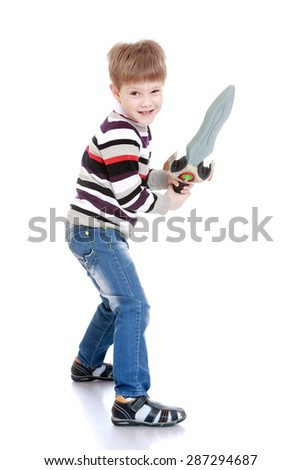 Funny little boy with a toy sword in hand-Isolated on white background