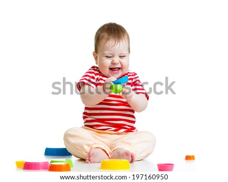 Funny little child playing with toys  isolated over white - stock photo
