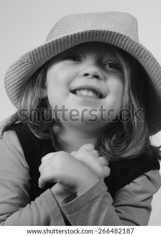 Funny little girl in a hat