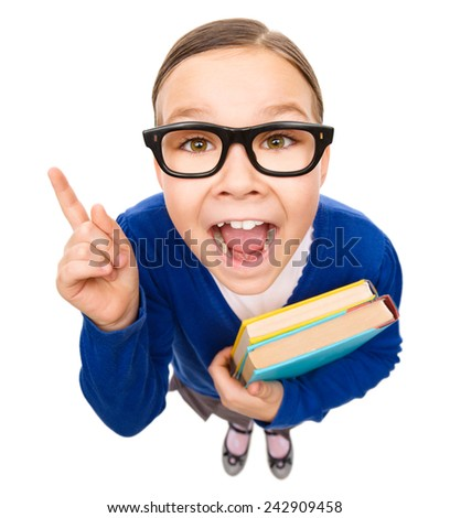 Funny little girl is holding books and explaining something pointing with her index finger, fisheye portrait, isolated over white - stock photo