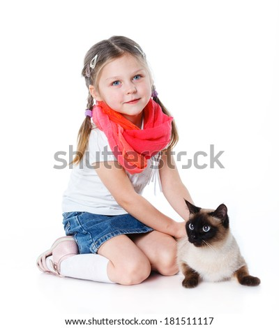 Funny little girl kid playing with cat. Isolated on white background.