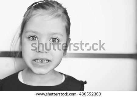 funny little girl lost her first tooth - stock photo