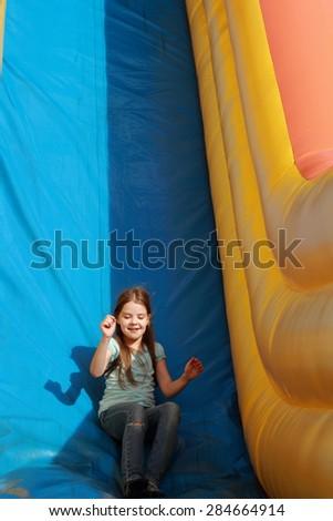 Funny little girl on trampoline - stock photo