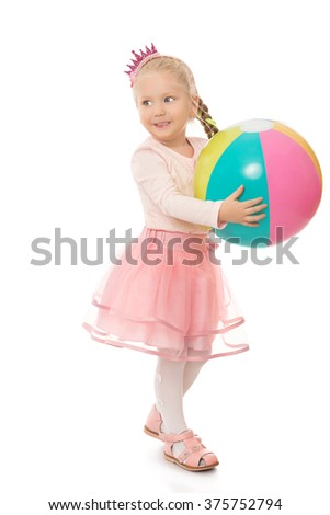 Funny little girl playing with ball - Isolated on white background - stock photo