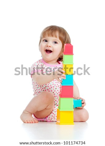 Funny little girl playing with cup toys, isolated over white - stock photo