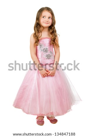 Funny little girl posing in nice pink dress. Isolated on white