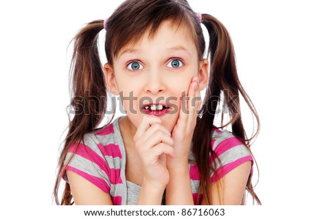 funny little girl pull faces. isolated on white background - stock photo