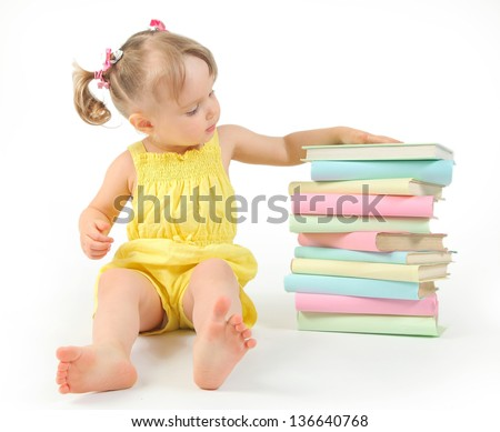 funny little girl reading books - stock photo