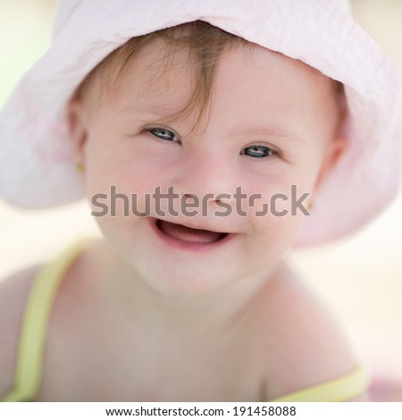 funny little girl resting on the beach