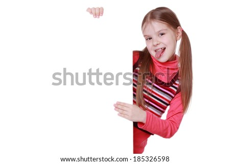 Funny little girl show us tongue with blank over white board
