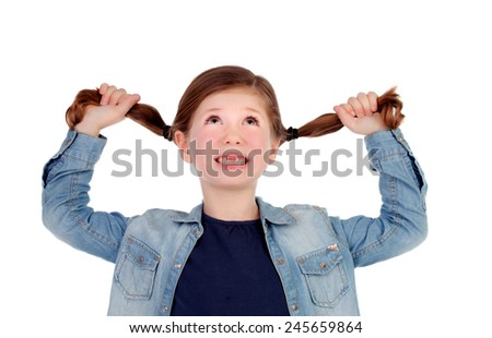 Funny little girl toothless pulling her pigtails isolated on a white background - stock photo