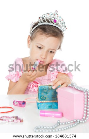 Funny little girl with a pink lipstick and accessories over white background