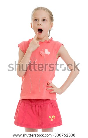 Funny little girl with blond hair braided in pigtails wearing a pink sweater and pink skirt. Girl gapes in surprise looking away, close-up-Isolated on white background - stock photo