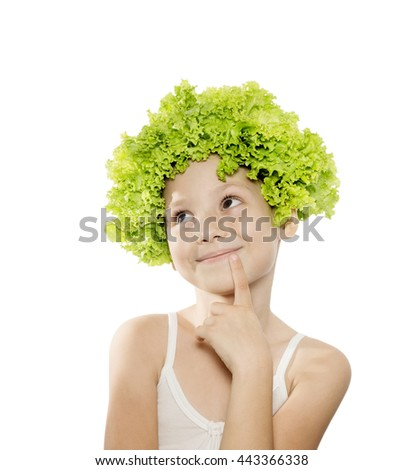 Funny little girl with green lettuce hair looking up. Healthy lifestyle, vegetarian food background. Isolated - stock photo