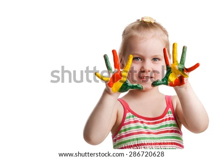 Funny little girl with hands painted in colorful paint. Isolated on white background - stock photo