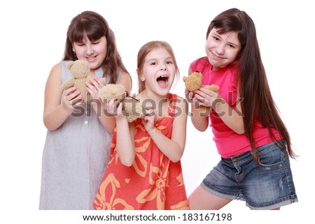 Funny little girls holding toy bear isolated