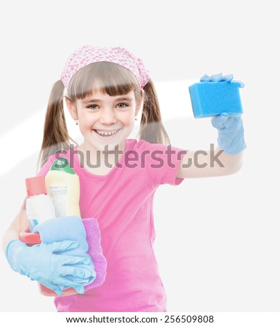 Funny little housewife cleaning window - stock photo