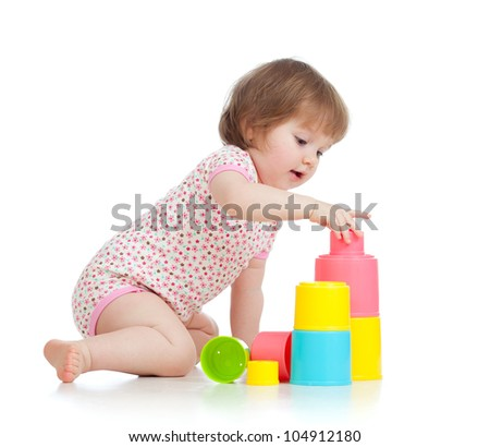 Funny little kid playing with cup toys, isolated over white - stock photo