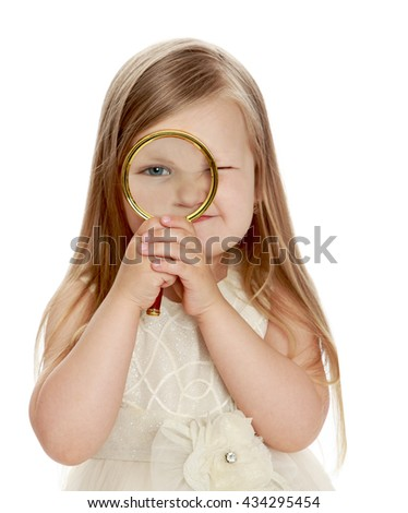 Funny little round-faced girl with long, blonde hair, looking at camera using a big magnifying glass . Close-up - Isolated on white background - stock photo