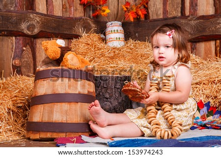 funny lovely baby girl little child in trendy dress on hay. happy kid playing game. Cute adorable child baby American girl. Beautiful expressive laughing smiling baby infant toddler