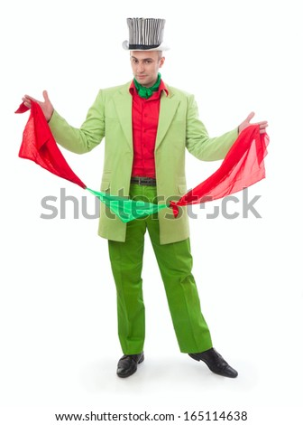 Funny magician in a green suit on a white background - stock photo