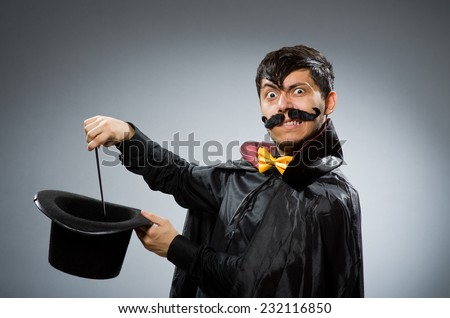 Funny magician man with wand and hat - stock photo