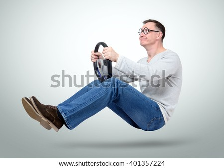 Funny man car driver with a wheel. Dummy on road concept - stock photo