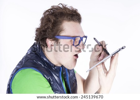 funny man drawing on a graphics tablet - stock photo