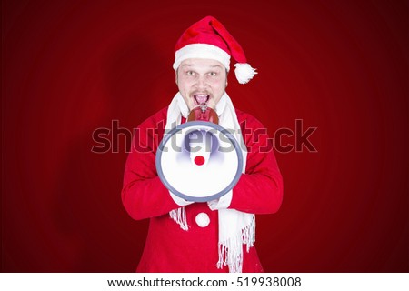 Funny man dressed as santa claus with megaphone