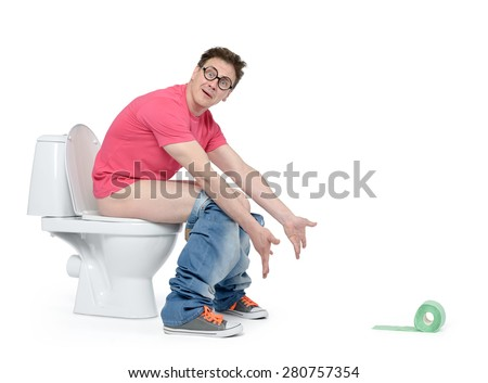 Funny man dropped the toilet paper sitting on the toilet. Isolated on white background. Situation concept - stock photo