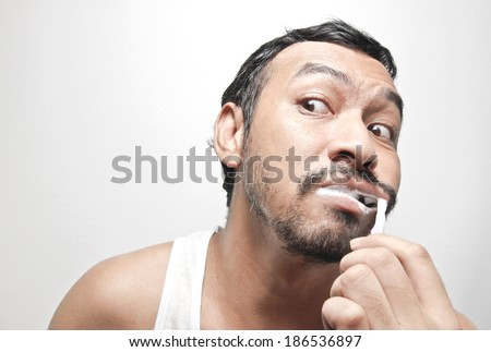 funny man excited brushing his teeth in morning, late