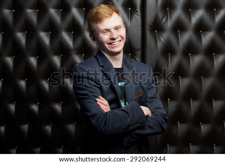 Funny man in a black suit.isolated studio portrait - stock photo