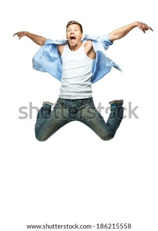Funny man in blue shirt and jeans jumping