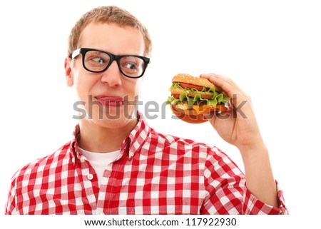 Funny man in glasses eating hamburger isolated on a white - stock photo
